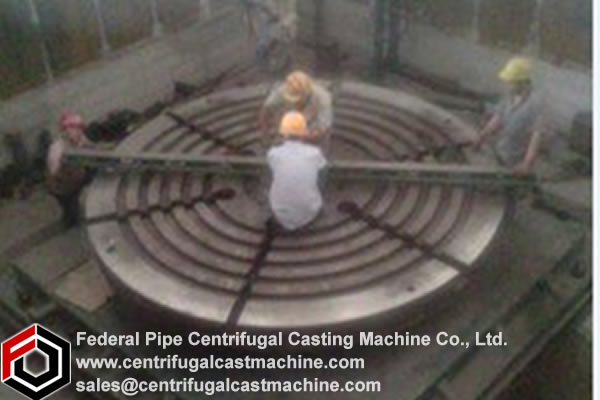 Pit-mounted vertical centrifugal casting machine.