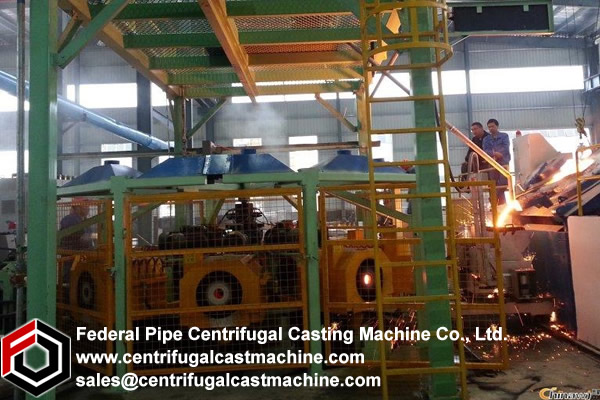 A centrifugal casting machine comprising a vertically movable