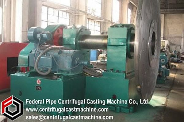 improved construction for a centrifugal casting machine such as used in casting gun tubes.