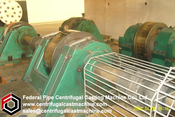 Centrifugal casting machine with venturi actuated vacuum venting